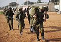 "Flickr - Israel Defense Forces - Soldiers Carry ""Wounded"" During Field Doctor Exercise, Oct 2010.jpg"