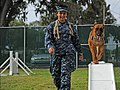 Flickr - Official U.S. Navy Imagery - A K-9 handler with the military runs her K-9 partner through an obstacle course at the base kennel..jpg