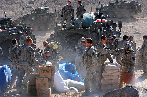 U.S. soldiers unload humanitarian aid for distribution to the town of Rajan Kala, Afghanistan, 5 December 2009 Flickr - The U.S. Army - Humanitarian aid in Rajan Kala, Afghanistan.jpg