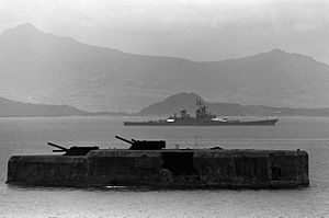Fort Drum in 1983, with USS New Jersey in the background