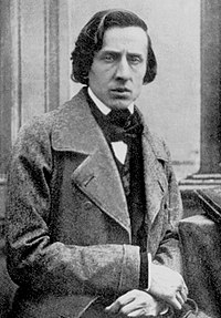 Chopin faces the viewer, wearing an overcoat