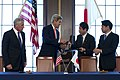 From left, U.S. Secretary of Defense Chuck Hagel and U.S. Secretary of State John Kerry pass a document to Japanese Minister of Foreign Affairs Fumio Kishida and Japanese Minister of Defense Itsunori Onodera 131003-D-BW835-801.jpg