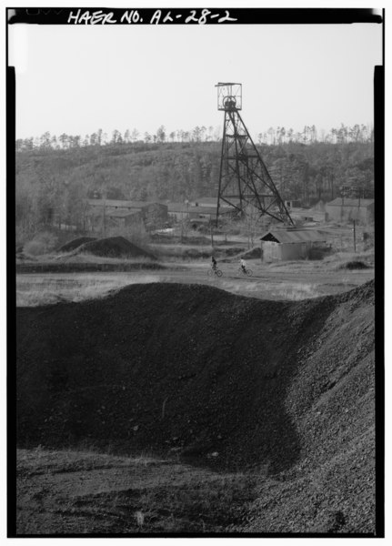 File:GENERAL VIEW OF PYNE MINE COMPLEX WITH HEADFRAME TO CENTER, LOOKING SOUTHWEST (WITH CYCLISTS). - Pyne Red Ore Mine, State Route 150, Bessemer, Jefferson County, AL HAER ALA,37-BES.V,9-2.tif