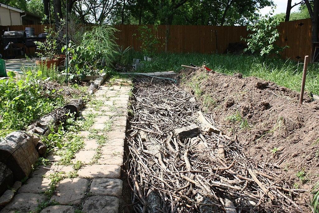 hugelkultur-wood-in-trench