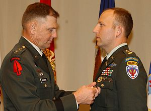 5th Special Forces Group (United States) - Major Mark E. Mitchell is decorated for his combat actions during the battle by General Bryan D. Brown, chief of the U.S. Special Operations Command