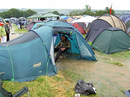 A stream runs through a tent after two inches of rain fell in an hour on Friday morning of the 2005 festival Glastonbury 2005 River Through Tent.jpg