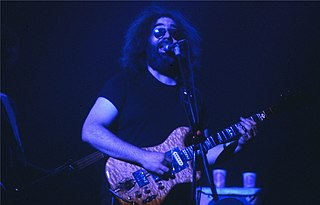 Jerry Garcia. Photo taken in New Haven, CT at the Jerry Garcia WPLR Show - Image Credited to Wikimedia Commons