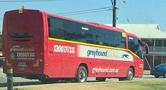 Greyhound Australia - Irizar Century bodied Mercedes-Benz OH1830 in Perth in October 2013 with fluorescent yellow stripe and hazard light for operation on mining sites