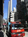 HK Sai Ying Pun 西環 皇后大道西 Queen's Road West sunny day Hino Amoy truck in red July-2012.JPG