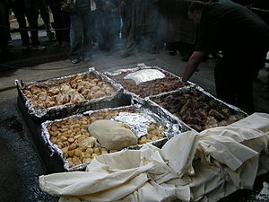 New Zealand cuisine - Preparation of a modern hāngi for tourists at Mitai Maori Village, Rotorua.