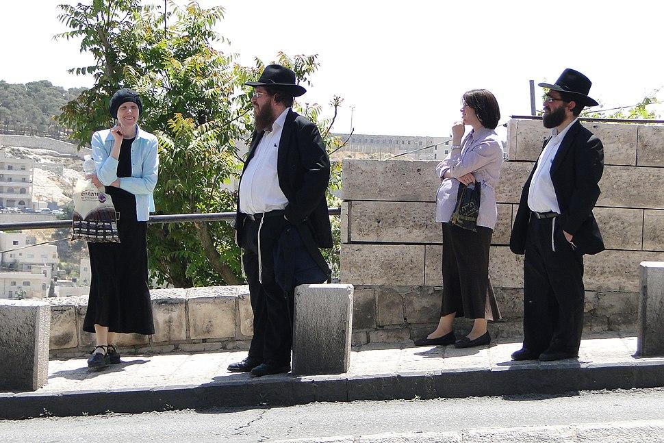 Haredi (Orthodox) Jewish Couples at Bus Stop - Outside Old City - Jerusalem (5684561290)