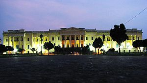 Mubarak Ali Khan II - The grand Hazarduari Palace illuminated at night.