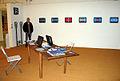 Helmut Hennig neben seinem interaktiven Videofries auf der Art (F)Air 2012, Messe für zeitgenössische Kunst in Hannover.jpg