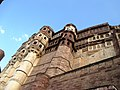 High and mighty walls of the Mehrangarh Fort.jpg