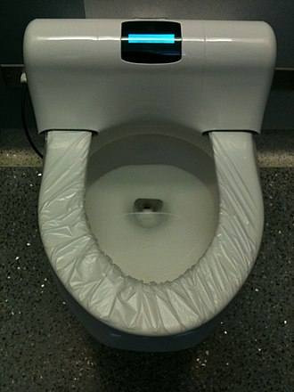 Automatic self-clean toilet seat - An automatic seat film replacer at Chicago O'Hare International Airport. March 2010