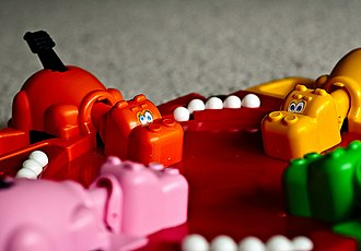 Hungry Hungry Hippos - Happy Hippo (pink), Henry Hippo (orange), Homer Hippo (green), and Harry Hippo (yellow)