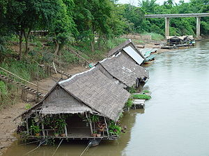 Khwae Noi River - Typical river houses with thatched roofs on the River Kwai