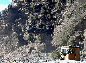 Chinook helicopter above Combat Outpost Keatin...