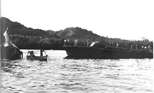 Japanese submarine I-1 (1924) - The crew of U.S. PT boat ''PT-65'' inspects the wreckage of Japanese submarine I-1