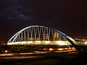 The Des Moines skyline as seen through the Edna M. Griffin Memorial Pedestrian Bridge over Interstate 235.