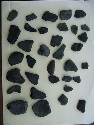 """Sea glass - This """"black"""" sea glass was collected in Jamaica 24 Dec. 2009. Under good light the green shade of the original glass before weathering is revealed."""