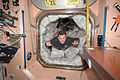 ISS-20 Roman Romanenko floats through a hatch into the Unity node.jpg