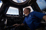 ISS-43 Terry Virts checks the Canadarm2 from the Cupola.jpg