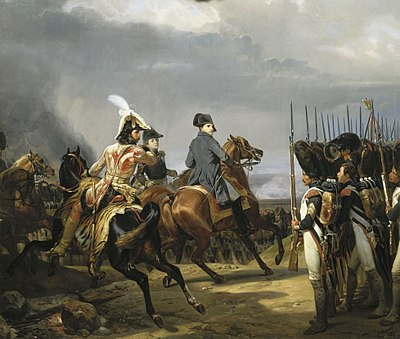 Napoleon on horseback, reviewing a rank of Imperial Guards in bearskin hats