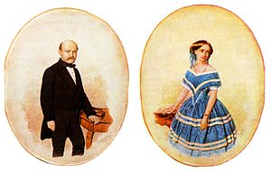 At left, a painting of a balding, mustachioed middle-aged man in black-tie formal attire standing beside a red table. At right, a painting of a woman in a blue dress with white stripes, standing beside a red table.