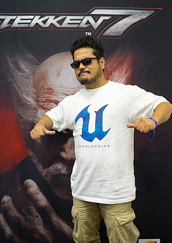 Executive producer Katsuhiro Harada had expressed interest in developing a new Tekken title for the PlayStation 4 since early 2014 Igromir 2016 (29382037694).jpg