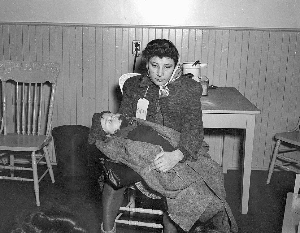 Immigrant Woman with Baby, Pier 21, Halifax, Nova Scotia, Canada, 1948
