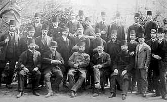 Simon Agopyan - Taken between 1885 and 1887, the photograph depicts the teachers and students of the Imperial Fine Arts School. Simon Agopian is standing in the centre of the second row, fifth from the left.