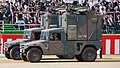 JGSDF High Mobility Vehicle(06-7521, 06-7523) with shelter of JMRC-C6-B left front view at Camp Itami October 8, 2017 02.jpg