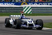 "Juan Pablo Montoya driving the Williams with the ""Walrus-Nose"" design FW26 during the 2004 United States Grand Prix. Montoya had qualified in fifth for the race, but he was disqualified for Illegally using the spare car"