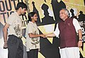 Jairam Ramesh with the Youth Tiger Ambassadors, Anusha Shankar and Devanshu Sood, who represented India at International Youth Tiger Summit in Vladivostok, Russia, in New Delhi on November 12, 2010.jpg