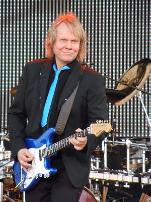 """James Young (American musician) - James """"J.Y."""" Young performing with Styx on July 2, 2010 at Memorial Park in Omaha, Nebraska"""
