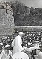Jawaharlal Nehru being greeted by Gudolia Lohars, Chittor Fort, 6 April 1955.jpg