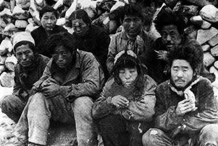 Suspected communist sympathizers awaiting execution in May 1948 after the Jeju Uprising Jeju Massacre.jpg