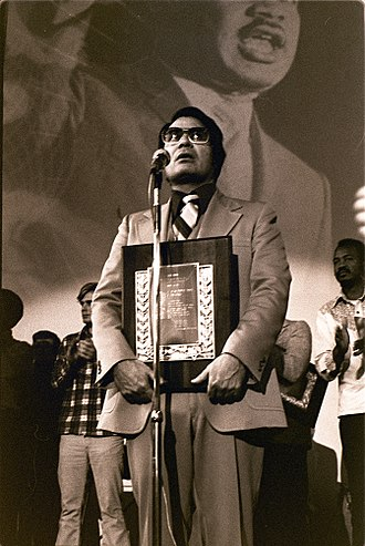 Peoples Temple - Rev. Jim Jones receives a Martin Luther King, Jr. Humanitarian award at Glide Memorial Church in San Francisco, January 1977.