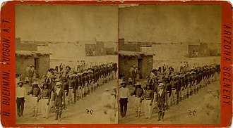 John Clum - John Clum (front right), Apache agent and Merejildo Grijalva, Apache captive, army scout and translator.