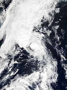 Satellite imagery of a disorganized tropical storm undergoing an extratropical transition.