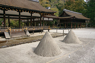 Kamo Shrine - Tatesuna are a pair of standing cones of sand in front of Sai-Den  at Kamigamo-jinja.  They are traditionally construed as allusions to a pair of sacred mountains.
