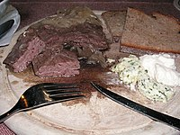 Kronfleisch (skirt steak), a traditional Bavarian dish often served with onion rings, rye bread, composed butter (with herbs and garlic) and horseradish.jpg