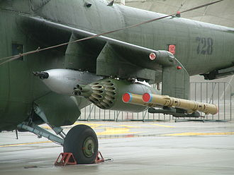 Air-to-ground weaponry - Autocannon pod (left), S-8 rocket pod (middle) and 9K114 Shturm anti-tank missile (right) mounted on the left wing of a Mi-24W helicopter of Polish Land Forces