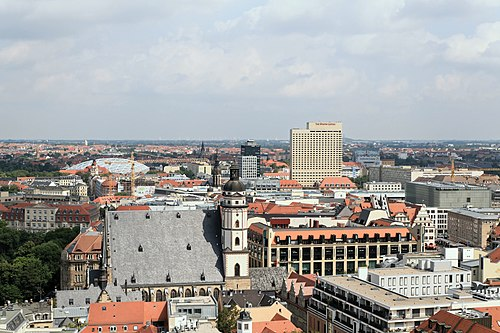 Typically dense cityscape of Leipzig old town, view from Neues Rathaus. Buildings from left to right: Gondwanaland of Leipzig Zoo, St. Thomas Church, Highrise of Sparkasse Leipzig Bank, Hotel The Westin Leipzig and Museum of Fine Arts to the right. Leipzig (Rathausturm, Neues Rathaus) 11 ies.jpg