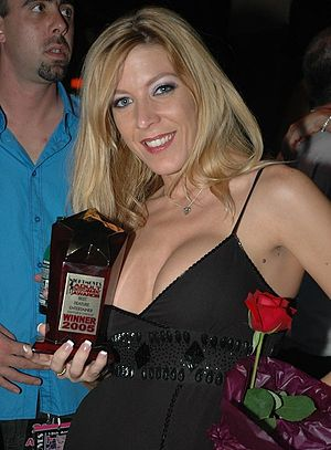 NightMoves Award - Lexi Lamour holding her Best Feature Dancer trophy at the 2005 NightMoves Awards Show