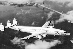 A MATS C-121G Super Constellation flying near the Golden Gate Bridge.