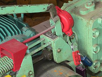 Lockout-tagout - A lockout device applied to a hoist brake. This prevents unintended movement of the hoist. The lockout hasp is secured with two padlocks.