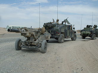 M102 howitzer - M102 howitzer belonging to Battery A, 1-206th FA, is towed north from Camp New York, Kuwait by a M1114 Up-Armored HMMWV.