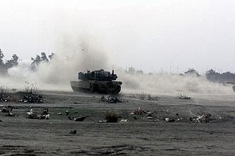 Battle of Umm Qasr - A U.S. Marine M1 Abrams tank fires its 120mm cannon at Iraqi forces during fighting near Umm Qasr, 23 March 2003.